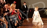 A humanitarian fashion show for the children of the receptionist.